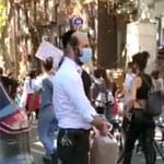 Watch: Frum Man In Williamsburg Giving Out Water Bottles To Both NYPD Officers And Protesters Today